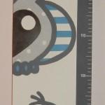 Groeimeter in de stijl van het geboortekaartje en de babykamer
